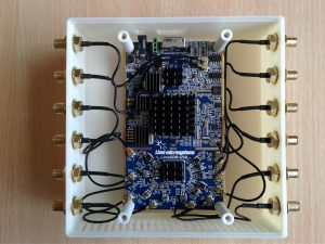 A top picture of the LimeSDR in its case with heatsinks.
